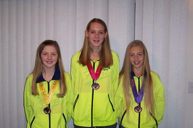 Heather, Ali, and Sydney with their medals